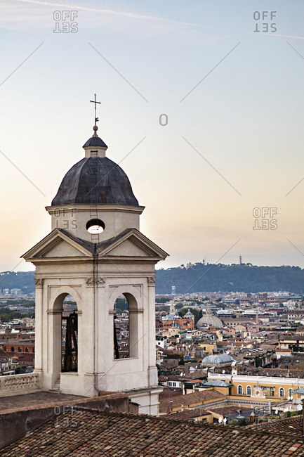 View of historic church tower and rooftop in Rome