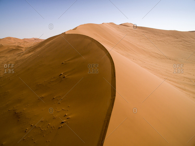 Africa, Namibia, Namib Naukluft National Park, Aerial view of windblown red sand dunes in Namib Desert near Sossusvlei