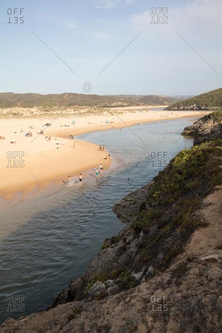 Paraiso Do Mar, Portugal - August 6, 2017: Bathers on the beach