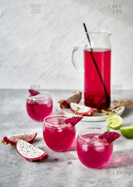 Refreshing tropical dragon fruit shrub drink with lime and thyme
