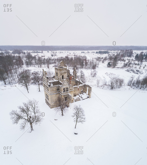 Aerial view of Ungru Lossi Varemed ruins of an old manor covered with snow near Haapsalu, Estonia