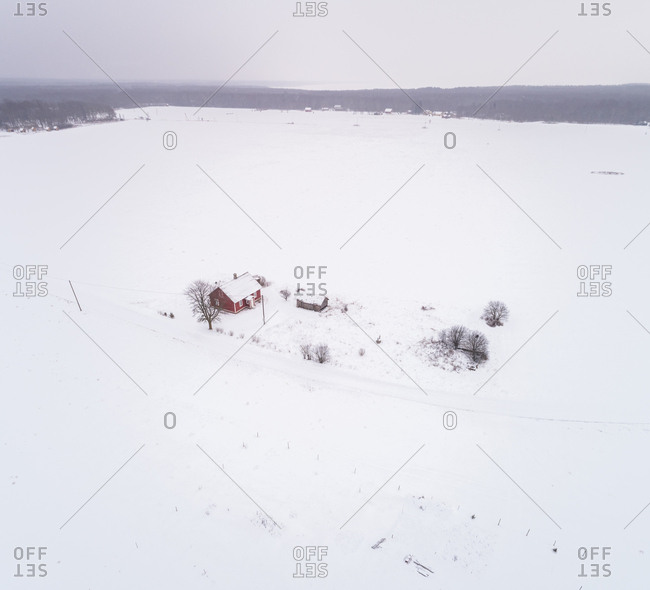 Aerial view of a small traditional house isolated in the nordic landscape, Estonia