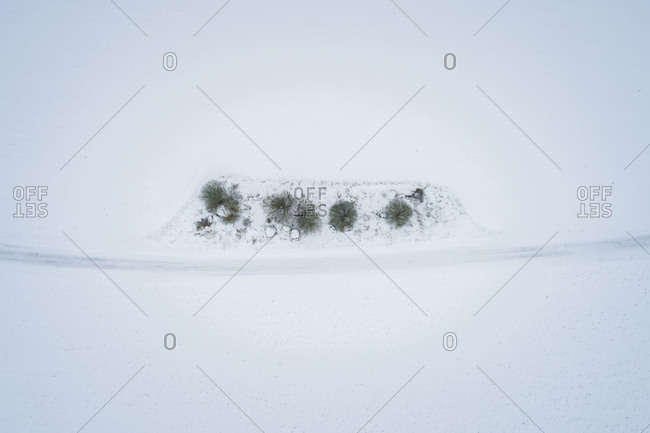 Aerial view of a nordic landscape and road covered with snow, Estonia