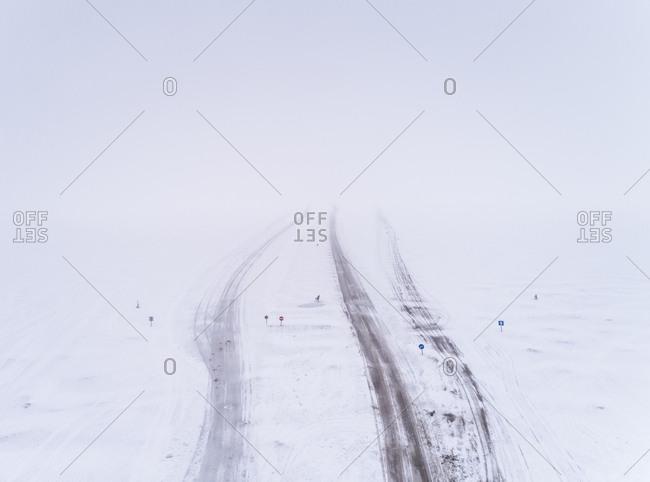 Aerial view of a frozen road in the Blizzard in Rohukula, Estonia