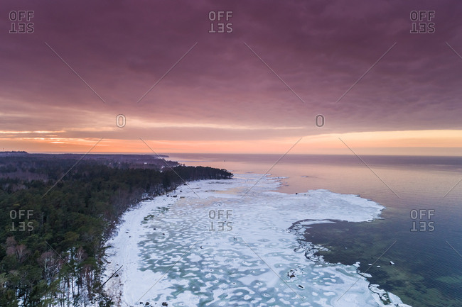 Aerial view of the frozen sea on the coast of Muraste at sunset, Estonia
