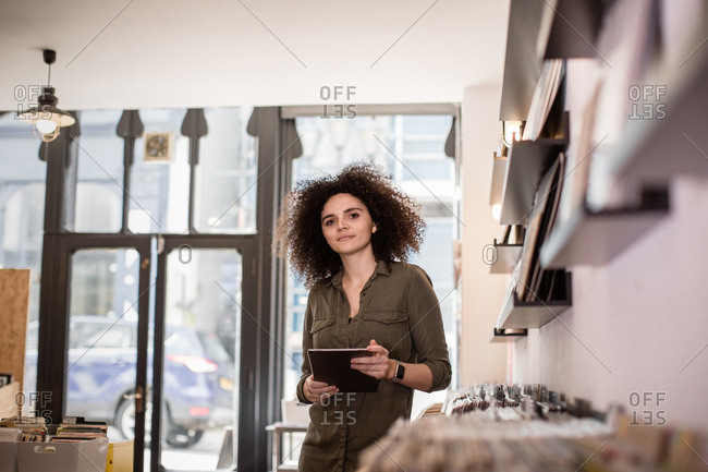 Portrait of small business owner holding digital tablet
