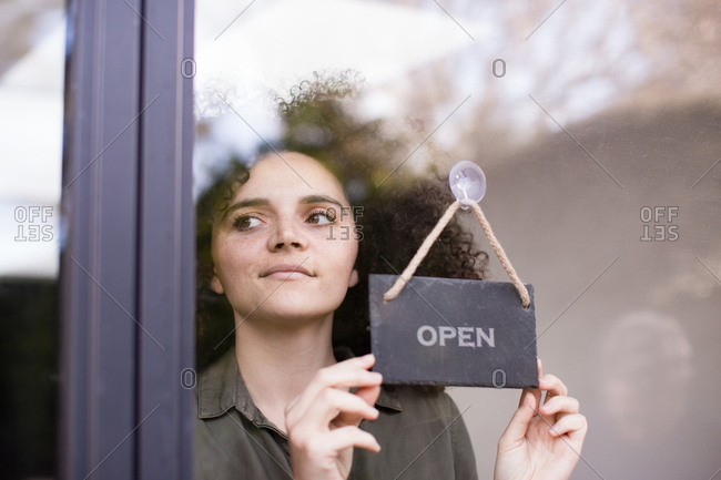Small business owner opening store