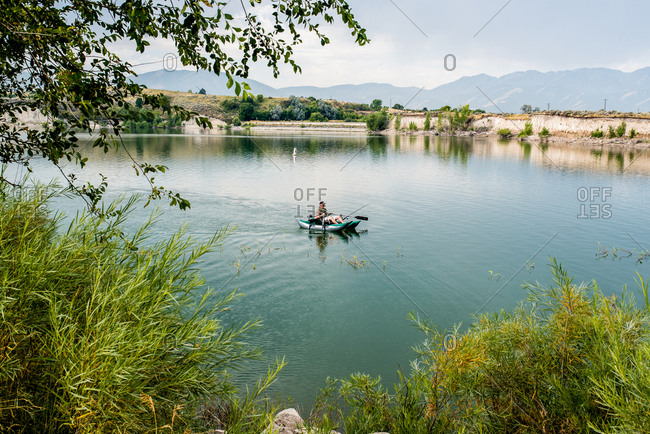 Man on a miniature pontoon boat in a lake
