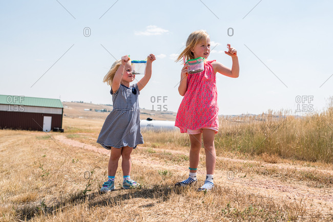 Two girls with bug collections