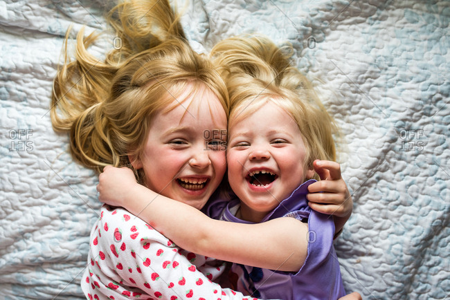 Smiling little girls with their arms around each other