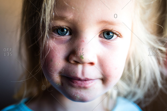 Close up portrait of little girl with messy face