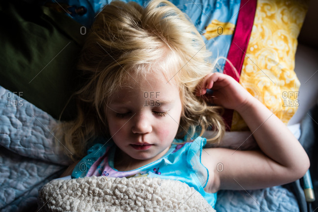 Sick little girl having a nap