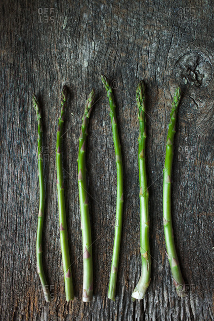 Asparagus on a rustic wood background