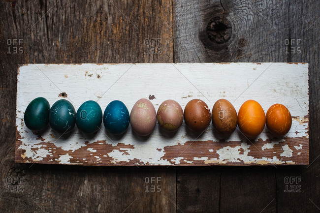 Dyed Easter eggs on a wooden board