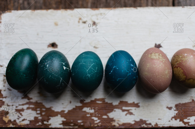 Close up of Easter eggs on a wooden board