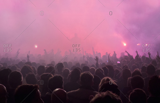 London, UK - April 05, 2018: Crowd of people facing a stage during a performance