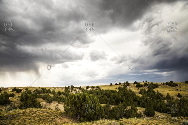 Storm clouds gathering over dry landscape