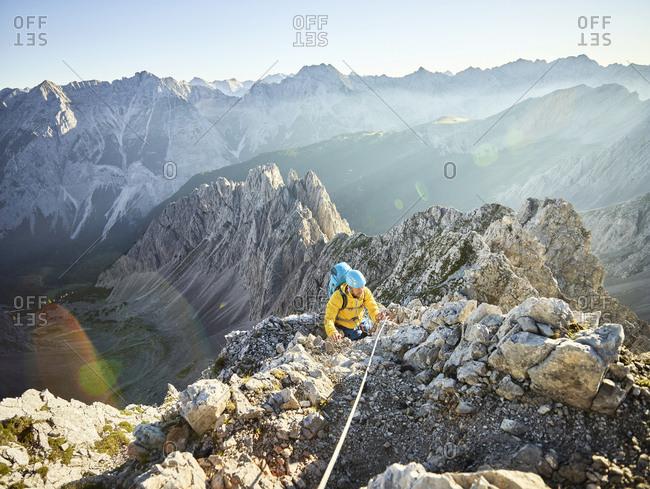 Austria- Tyrol- Innsbruck- mountaineer at Nordkette via ferrata
