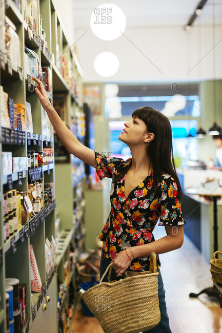 Customer looking for product at shelf in a store