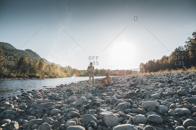 Canada- British Columbia- Chilliwack- two men resting at Fraser River