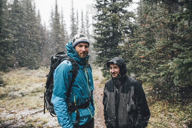 Canada- British Columbia- Yoho National Park- portrait of two smiling hikers in snowfall