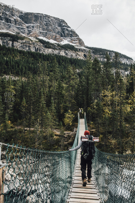 Canada- British Columbia- Mount Robson Provincial Park- two men on swinging bridge on Berg Lake Trail