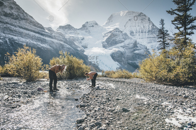 Canada- British Columbia- Mount Robson Provincial Park- two men washing in a brook