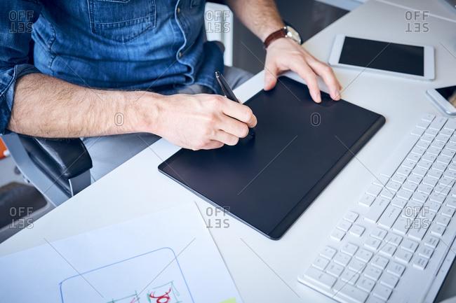 Close-up of graphic designer sketching website layout