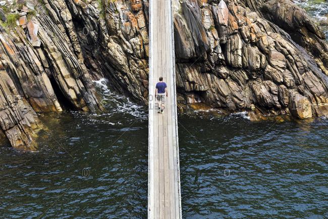 Africa- South Africa- Western Cape- Paarl- Garden Route National Park- Tsitsikamma National Park- man walking on wooden bridge