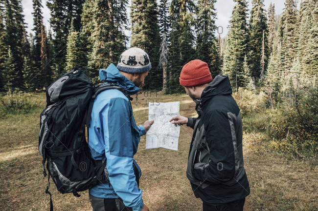 Canada- British Columbia- Yoho National Park- two hikers reading map at Mount Burgess