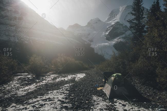 Canada- British Columbia- Mount Robson Provincial Park- man with tent at Berg Glacier