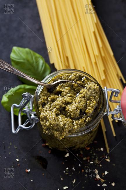 Preserving jar of basil pesto