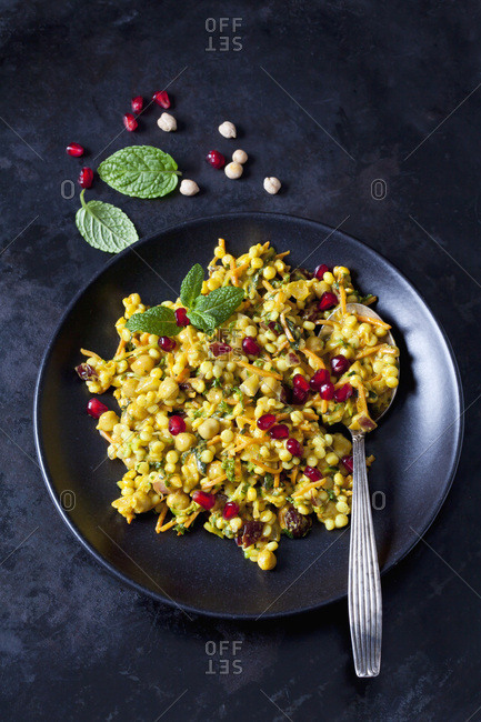 Bowl of Couscous salad with chick peas and cranberries