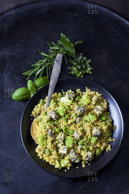Bowl of quinoa salad with broad beans- peas and feta