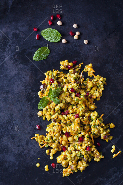 Couscous salad with chick peas and cranberries on dark ground