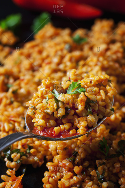 Spoon of bulgur wheat salad- close-up