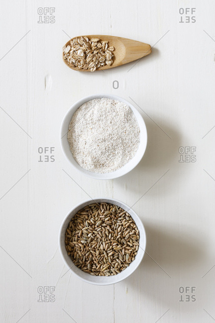 Rye flakes- rye flour and rye grains on white background