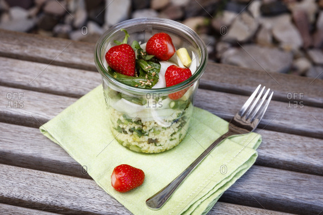 Asparagus salad with millet- strawberry- rocket in glass