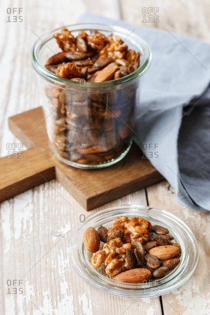 Homemade roasted flavored nuts- almonds- walnuts and pumpkin seeds in glass