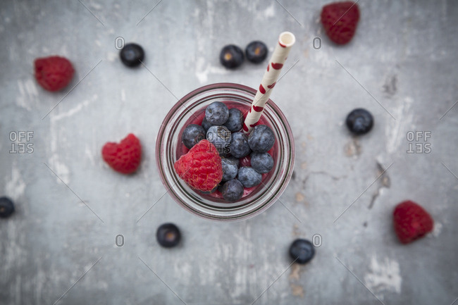 Glass bottle of berry smoothie