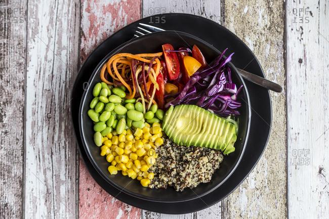 Quinoa veggie bowl of avocado- Edamame- tomatoes- corn- red cabbage and carrots