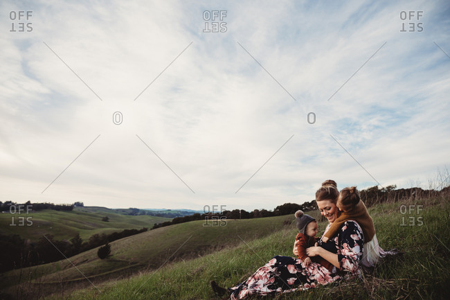 Mother with two kids on mountain hillside