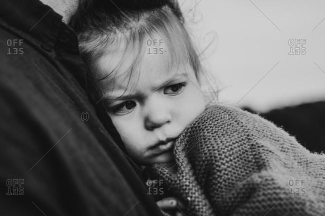 Young girl cuddling looking sad