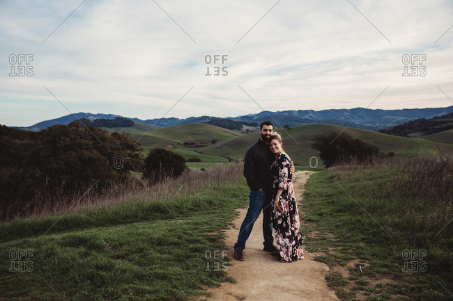 Couple hugging on top a mountain