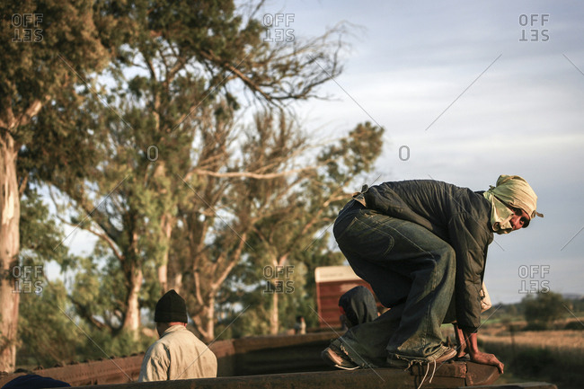 Mexico - November 07, 2007: Young migrant preparing to jump off train hoping to cross border into United States of America