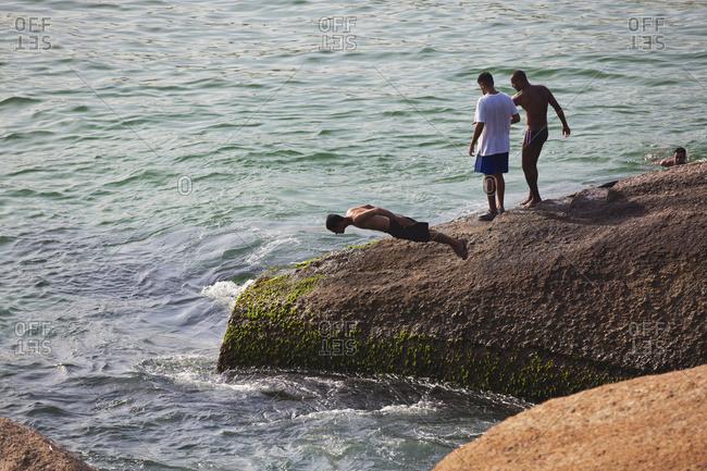 April 6, 2018: Diving Into The Sea Off Rocks Along The Coast; Rio De Janeiro, Brazil