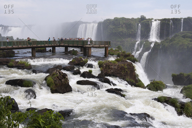 April 6, 2018: Tourists Crowd On To Concrete Walkways Above The Waterfalls At Iguacu National Park; Brazil