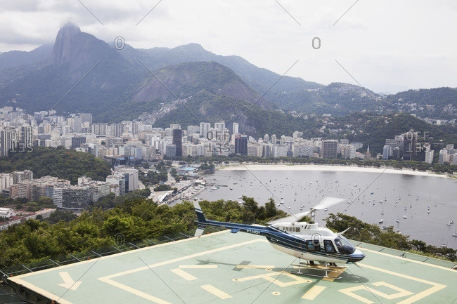 April 6, 2018: Sightseeing Helicopter At Top Of Sugarloaf Mountain, Looking To Botafogo Bay; Rio De Janeiro, Brazil