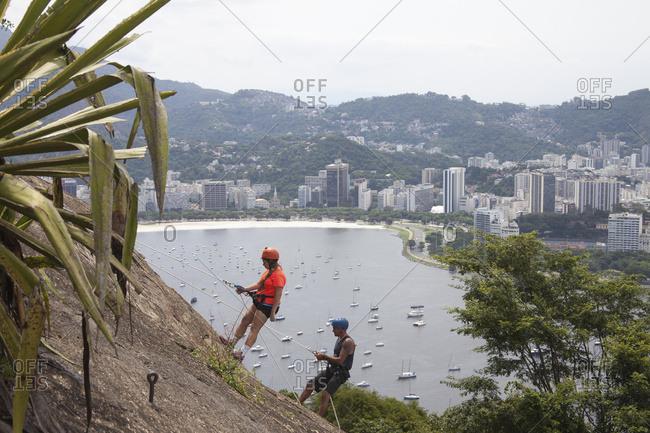 April 6, 2018: Rock Climbing Up Sugarloaf Mountain, Looking To Botafogo Bay; Rio De Janeiro, Brazil