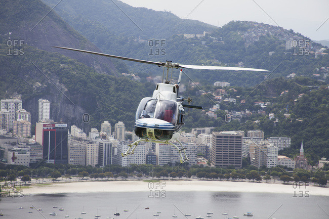 April 6, 2018: Sightseeing Helicopter Seen From Sugarloaf Mountain, Looking To Botafogo Bay; Rio De Janeiro, Brazil